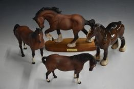 Four Beswick horses comprising Spirit of Earth, Swish Tail, Mare Facing Right and Standing Shire