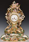 A 19th/20thC continental porcelain flower encrusted mantel clock and stand, H46cm