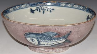 English Delftlargepedestal bowl, London c 1750, the exterior decorated with three fish against a