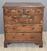 18th/19thC oak chest of two over three drawers with crossbanded and feathered decoration, raised