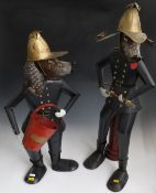 Two modern metal figures of dogs as firefighters one with a bucket (H71cm) the other with a fire