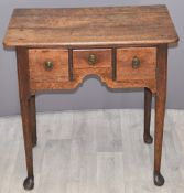 Georgian oak sidetable or lowboy with three drawers and shaped under stretcher W68 x D46 x H69cm