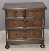Carolean style oak bachelor's chest of drawers raised on bun feet, W76 x D44 x H76