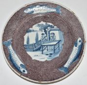 English Delft plate, London c1750, decorated with a chinoiserie garden scene of two figures at a