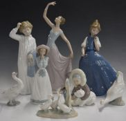 Eight Lladro and Nao figures, tallest 35cm