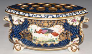 A 19thC porcelain bough pot with peacock decoration, H9.5cm
