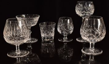 A collection of clear cut crystal drinking glasses including six Waterford brandy glasses, a set