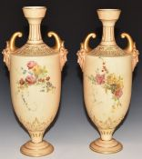 Pair of Royal Worcester blush ivory pedestal vases with twin mask handles, H27cm