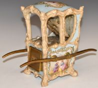 Dresden or similar porcelain sedan chair with drawer and upholstered interior, possibly a pin