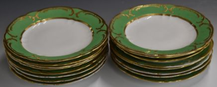 Sixteen Spode Felspar dinner plates with gilded decoration on a green ground, diameter 25cm