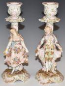 Pair of Continental porcelain figural candlesticks, H19.5cm