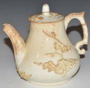 An 18th/19thC blanc de chine teapot with relief moulded decoration, H11cm