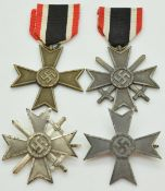 Four German WW2 Third Reich Nazi War Merit Cross medals, two with crossed swords, one stamped 3 to