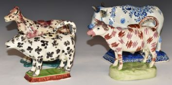 Three 18th/19thC Spongeware cow creamers and an 18thC Delft cow with milkmaid, signed Jacobus Holder