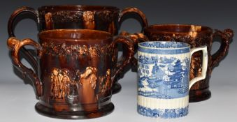 Three Rockingham oversized frog loving cups / tygs and a 19thC blue and white tankard, largest H22