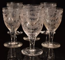 A set of six 19thC clear glass wine glasses with engraved decoration of birds, flowers and