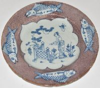 English Delft plate, London c1750, decorated with a chinoiserie garden scene within a border of four