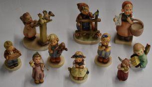 Ten Hummel Goebel figures including 'Signs of Spring', 'Monkey Business' and 'Love Petals'