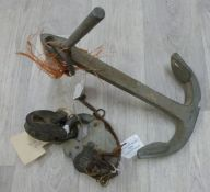 A metal boat anchor together with two swing bridge padlocks and keys, one stamped Trade Mark.
