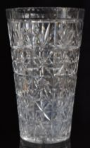 A large cut glass vase with star cut base, 36cm tall.