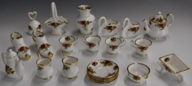 Approximately twenty one pieces of Royal Albert Old Country Roses miniature tea and ornamental ware