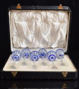 A set of six blue overlay cut glass liqueur glasses with octagonal stems and star cut bases, 14.