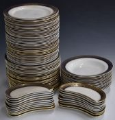 Approximately 95 pieces of Wedgwood and Co dinnerware decorated with a cobalt blue and gilt