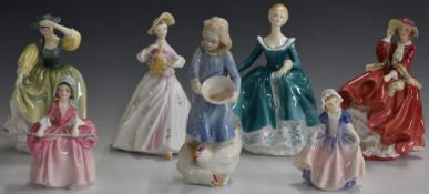 Six Royal Doultonfigurinesand one Royal Worcester, including Country Girl, Top O' The Hill, Bo