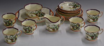 Approximately twenty one pieces of Fenton Art Decotea set hand decorated with flowers and a