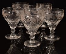 A set of six clear cut glass ale glasses with engraved decoration of barley and hops, raised on