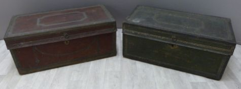Two metal bound twin handled trunks with studwork decoration and lined interiors, possible