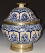 An 18th/19thC Islamic Hispano Moresque twin handled pedestal covered vessel with metal mounts, on