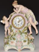 Volkstedt figural German mantel clock featuring lady and cherub, the Roman and Arabic dial enamel