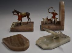 Pair of hunting interest bookends with alabaster bases and cold painted metal huntsmen with horse