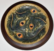 Moorcroft framed charger decorated in the Peacock Feather pattern, dated 96, diameter 30cm