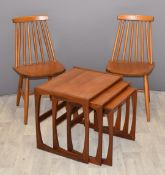 A pair of Ercol style beech stick back chairs and a retro set of three nest of three teak tables,