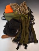 A collection of sporting or shooting equipment including game or fishing bag, gaiters, camouflage