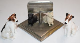 Two Royal Doulton K Series dog figures and a Buchanan's 'Black and White' Scotch Whiskey figural dog