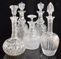 Five cut glass decanters including a pair of Georgian examples, largest 32cm tall.