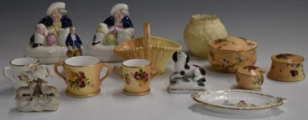 A collection of Royal Worcester miniatures, Staffordshire figural pen holders, Chelsea style