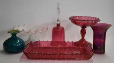Cranberry glass tray, tazza, tray, bell, frilled glass tazza and a Mdina vase, largest 30cm tall.