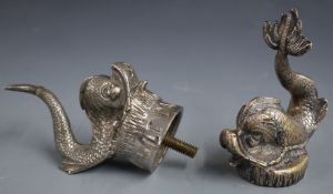 Two vintage car mascots formed as fish, one marked to base Le Dauphin, height of taller 13cm