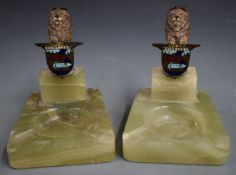Pair of BARC Brooklands ashtrays, surmounted by cold painted bronze or similar lions holding