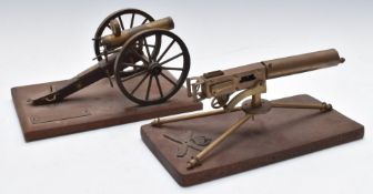 Two model machine guns with moving parts comprising Bullnoze Gatling example and one other, W22 x