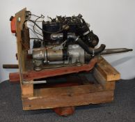 Three bearing Austin Seven engine, on test stand with ancillaries including carburettor, fuel