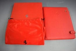 Ferrari red leather organiser, in original box with drawstring carry bag