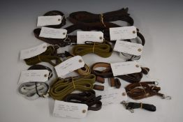 Collection of military rifle and machine gun slings including Bren Gun, Mauser, MP40, Thompson SMG