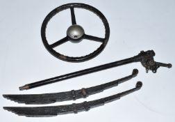 Austin Seven late type steering column, steering wheel and a pair of rear springs