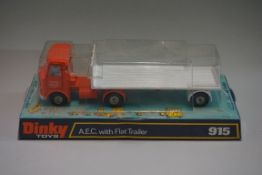 A Dinky 915 'AEC with Flat Trailer', in bubble box.