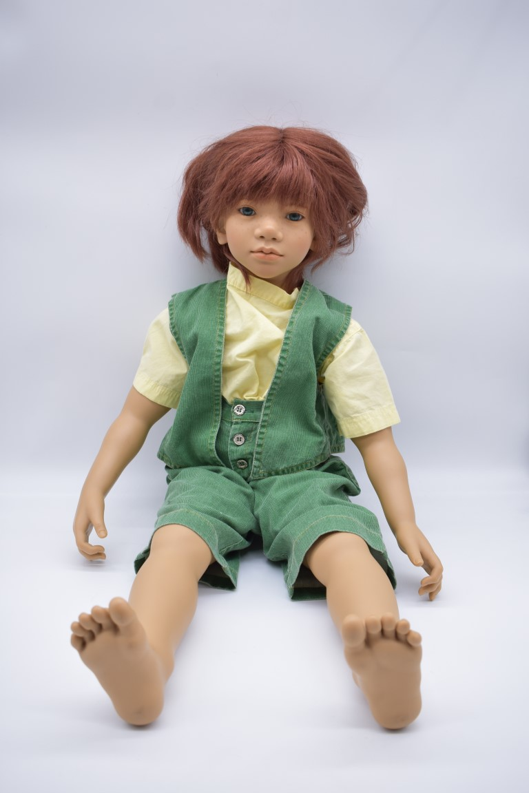 An Annette Himstedt 'Melvin' doll, boxed with certificate.